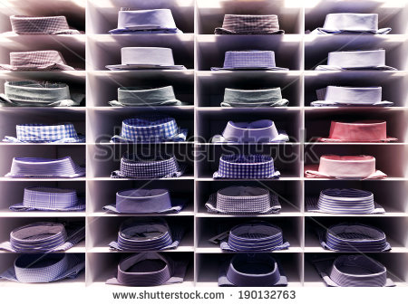 stock-photo-folded-colourful-shirts-on-clothes-rack-190132763